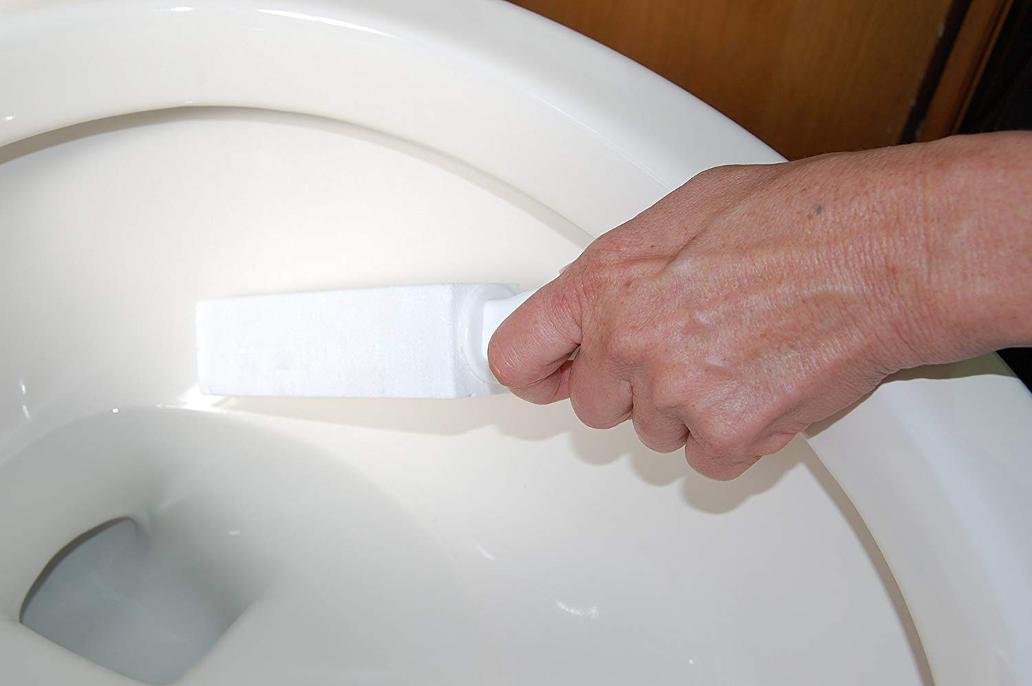 How to remove mineral deposits from the the toilet with a pumice stone