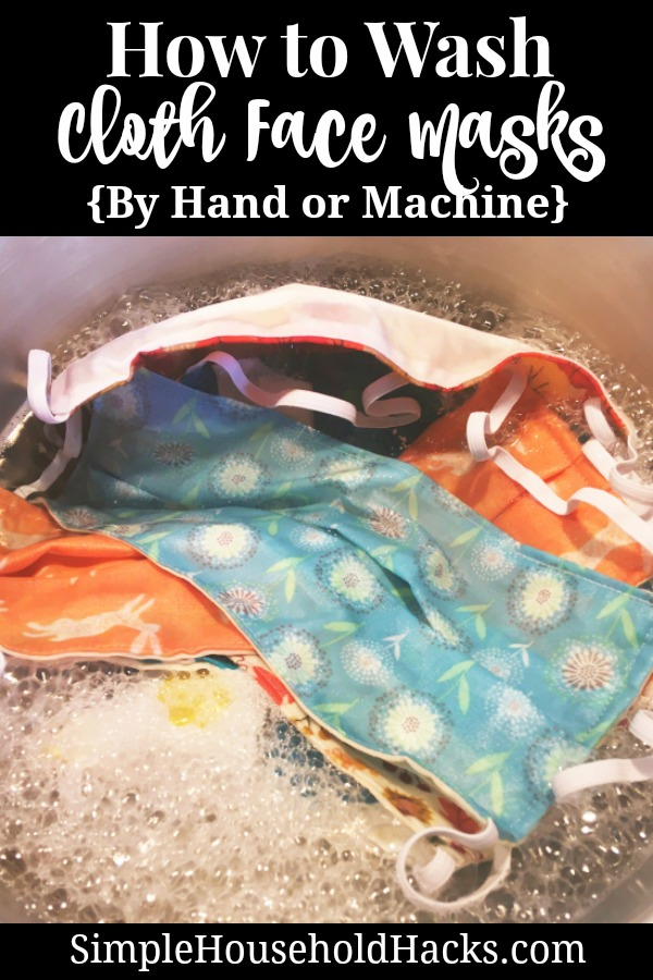 cloth face masks soaking in a sink of hot water and laundry soap